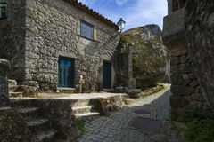 Narrow cobblestone street between bolders and houses in the historic village of Monsanto in Portugal Stock Photo
