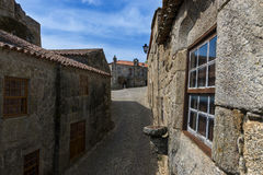 Narrow cobblestone street in the historic village of Sortelha in Portugal. Concept for travel in Portugal royalty free stock photos