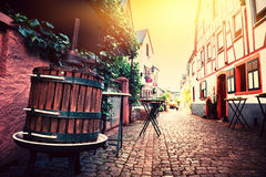 Narrow cobblestone street in old town. Cityscape Alsace, France Stock Photo