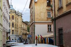 A narrow cobblestone street with a path in the historic center of Lviv.
