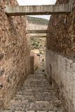 Narrow cobblestone street in Real de Catorce Mexico. May 22, 2014 Real de Catorce, Mexico: narrow cobblestone streets and mostly abandoned stone buildings all Stock Image