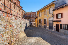 Narrow cobblestone street in town of La Morra. Stock Images