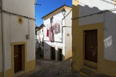 Narrow cobblestone street and traditional houses in the village of in Alentejo stock images