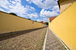 Narrow cobblestone street with wall, Prague, Czech Republic Stock Photography