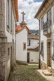 Narrow cobblestoned street in historical town Amarante stock photography
