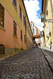 Narrow cobblestoned street Stock Photo