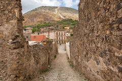 Narrow colonial street at Real de Catorce, Mexico. May 22, 2014 Real de Catorce, Mexico: narrow cobblestone streets and mostly abandoned stone buildings all Stock Image