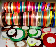 Narrow colored ribbons for needlework Royalty Free Stock Photos