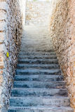 Narrow Concrete Steps Between Stone Walls Stock Photography