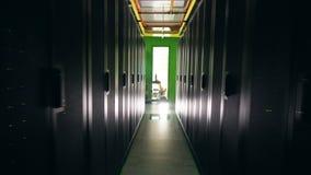 Narrow corridor between black server blocks. 4K stock video