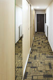 Narrow corridor with built-in mirror wardrobe Stock Image