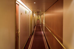 Narrow corridor with cabins Royalty Free Stock Image