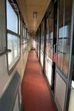 Narrow corridor in old train. Narrow corridor receding past compartment in old railway train Royalty Free Stock Photos