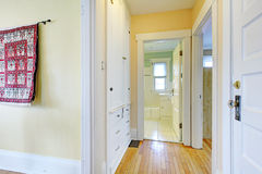 Narrow corridor with white built-ins Royalty Free Stock Photos
