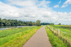 Narrow curved path on top of a dike Royalty Free Stock Photography