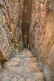 Narrow and dark alley in Atessa, Abruzzo, Italy Stock Image