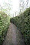 Narrow dead end street in an intricate maze Stock Photos