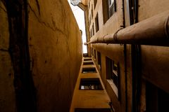 Narrow deadlock with a drainpipe in the downtown royalty free stock photos