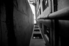 Narrow deadlock with a drainpipe in black and white royalty free stock images