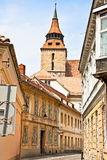 Narrow downtown street in Brasov, Romania. Stock Photos