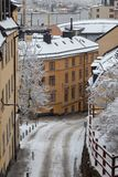 Narrow empty street with old buildings on a winter day with snow, Stockholm Sweden. Narrow empty street with old buildings on a winter day with snow with the royalty free stock images