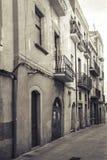 Narrow empty street view of Tarragona. Vintage stylized Royalty Free Stock Photos