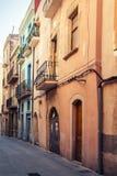 Narrow empty street view of Tarragona. Vintage stylized Stock Photo