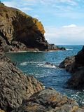 Cadgwith Cove Cornwall. The narrow entrance to Cadgwith Cove on the Lizard peninsula in Cornwall Royalty Free Stock Photography