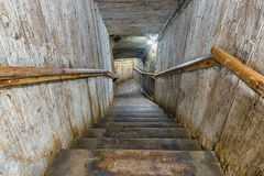 Narrow entrance wooden stairs Royalty Free Stock Images