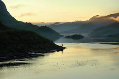 Narrow fjord with mountainous margins under mornin Stock Images