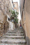 Narrow flight of stone steps in a village Stock Image