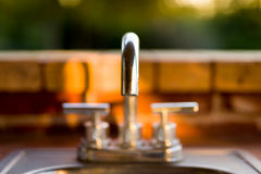 Narrow Focus View of an Outdoor Faucet Royalty Free Stock Photos