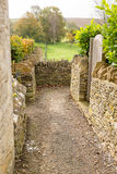 Narrow footpath between cotswold stone walls Stock Image