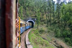 Narrow Gauge railway. A toy train on the 96 km mountainous Kalka-Shimla railway route from Kalka to Shimla. The 2 ft 6 inch narrow gauge railway has 864 bridges Royalty Free Stock Image