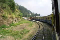 Narrow Gauge railway. A toy train on the 96 km mountainous Kalka-Shimla railway route from Kalka to Shimla. The 2 ft 6 inch narrow gauge railway has 864 bridges Stock Photography
