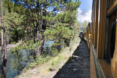 The Narrow Gauge Railway from Durango to Silverton that runs through the Rocky Mountains by the River Animas In Colorado USA Royalty Free Stock Photo