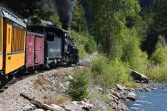 The Narrow Gauge Railway from Durango to Silverton that runs through the Rocky Mountains by the River Animas In Colorado USA Royalty Free Stock Photos