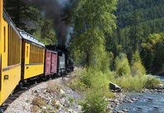 The Narrow Gauge Railway from Durango to Silverton that runs through the Rocky Mountains by the River Animas In Colorado USA Stock Photos