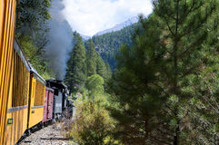 The Narrow Gauge Railway from Durango to Silverton that runs through the Rocky Mountains by the River Animas In Colorado USA. The town was organized in stock photo