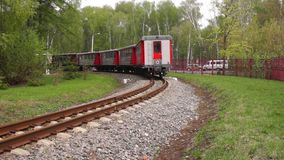 Narrow-gauge railway locomotive. The wagons of the narrow-gauge children`s railway go into the distance. Novomoskovsk, Tula, Russia stock footage