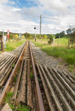 Narrow gauge railway or railroad track converging into distance Stock Image