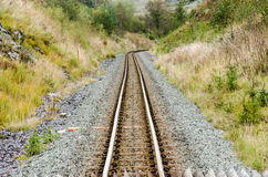 Narrow Gauge Railway. Track Going Down a Mountain Royalty Free Stock Image
