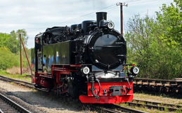 Narrow Gauge Steam Locomotive. Moving into station Royalty Free Stock Photography