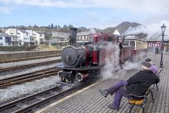 Narrow gauge steam locomotive in the station at porthmadog royalty free stock image