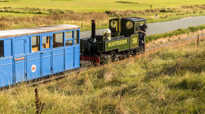 Narrow Gauge Steam Railway Train. Train travelling along the narrow gauge Fairbourne Steam  Railway. Barmouth, Gwynedd, Wales, UK Royalty Free Stock Photography