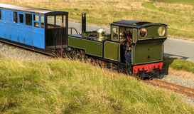 Narrow Gauge Steam Railway Train. Steam train travelling along the Fairbourne narrow gauge railway. Barmouth, Gwynedd, Wales, UK Royalty Free Stock Images