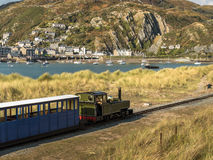 Narrow Gauge Steam Railway Train. Steam train travelling along the Fairbourne narrow gauge steam railway towards the seaside resort of Barmouth. Gwynedd, Wales Royalty Free Stock Photos