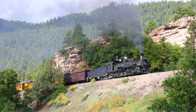 Narrow Gauge Train. A narrow gauge steam train climbs the grade on the Durango and Silverton railroad Royalty Free Stock Photography