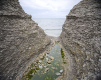 Narrow gorge and ocean Royalty Free Stock Photos