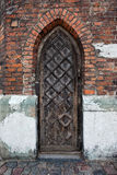 Narrow Gothic Wooden Door To A Church Stock Images
